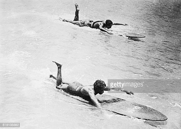 Here is shown a view of the recent surfboard swimming championships at Waikiki Beach where Duke Kahanamoku the champion in the event defended his...