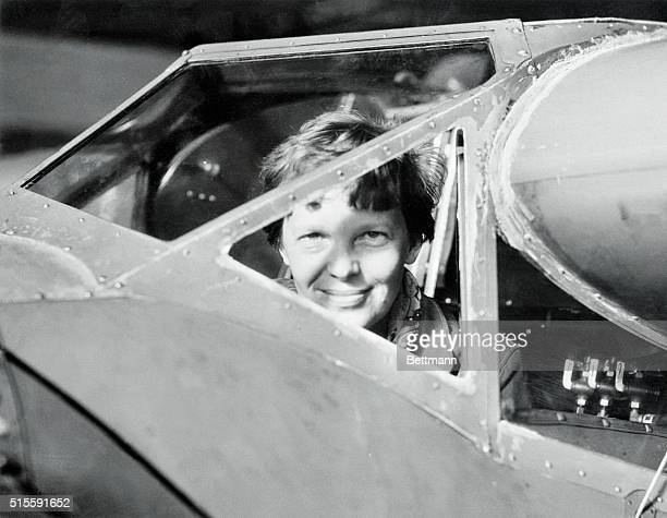 Here is the first photograph of Amelia Earhart Putnam at Wheeler Field U S Army Air Post in Hawaii where she was getting her plane ready for her...