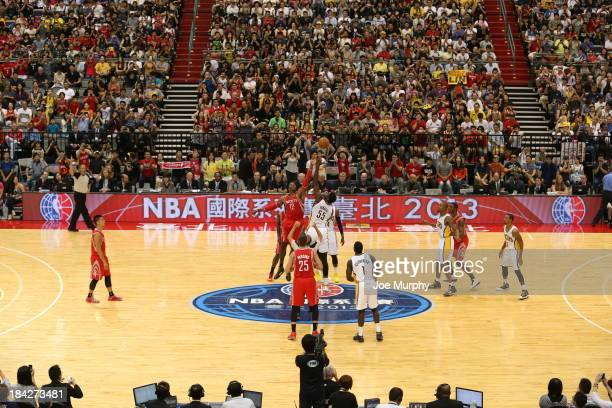 Here is the opening tip where the Houston Rockets take on the Indiana Pacers during the 2013 Global Games on October 13 2013 at the Taipei Arena in...