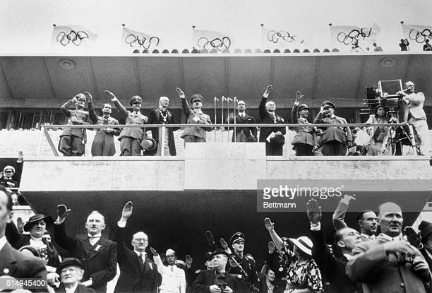 Here is the scene in the Olympic Stadium Berlin as Chancellor Adolf Hitler declared the Olympiad officially open Left to right on the platform are...