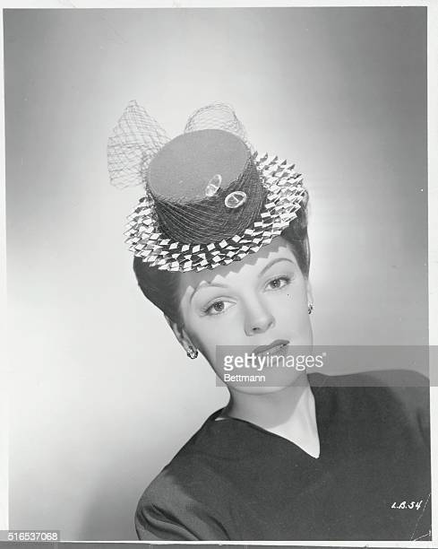 Here is your Easter bonnetA saucy navy blue and white checked brim sailor a popular new Spring mode modeled by Lynne Baggett Warner Bros feature...