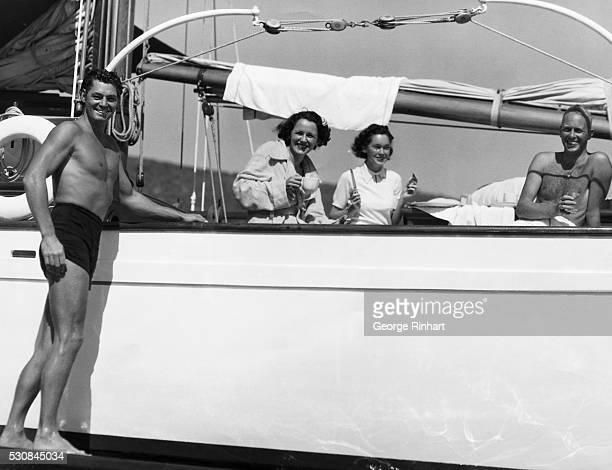 Here Johnny Weissmuller Maureen O'Sullivan Benita Hume and John Villiers Farrow are snapped aboard Johnny's yacht the Santa Guadalupe between work in...