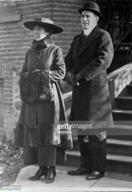 Here Miss Rankin is pictured in front of the old Rankin Home in Missoula with her brother Wellington, a Helena attorney who served as her campaign...