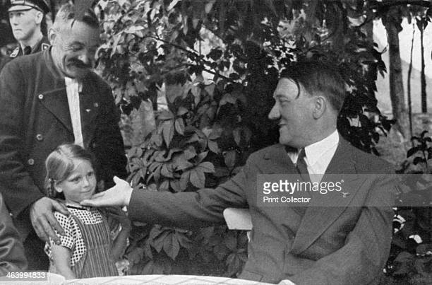 'Here my Führer is my grandchild' 1936 A man intoduces his young granddaughter to German Nazi leader Adolf Hitler A print from Adolf Hitler Bilder...