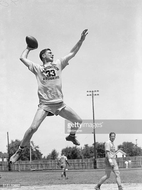 Here the Washington Redskins' halfback, Sammy Baugh, is seen jumping in the air and throwing a football.