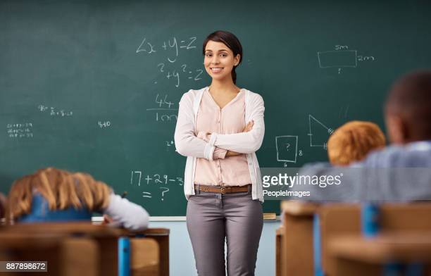 here to further enrich so many eager minds - teacher stock pictures, royalty-free photos & images