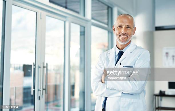 here to keep you at your healthiest - lab coat stock pictures, royalty-free photos & images