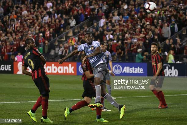 Herediano defender Keyner Brown watches as a header by Atlanta United forward Romario Williams sails into the goal in the second half the CONCACAF...