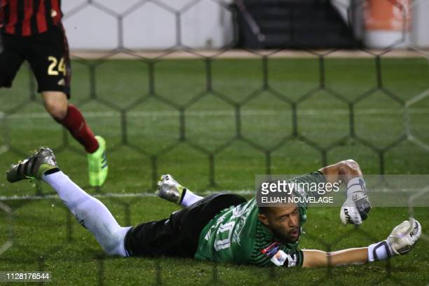 Herediano goalkeeper Daniel Cambronero reacts during the CONCACAF Champions League playoff football match between Atlanta United and Herediano at the...