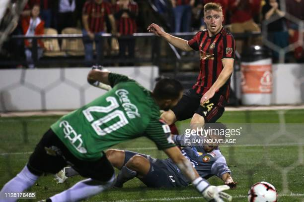 Herediano goalkeeper Daniel Cambronero stops a shot on goal by Atlanta United midfielder Julian Gressel in the second half of the CONCACAF Champions...