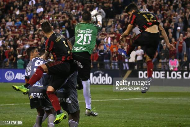 Herediano goalkeeper Daniel Cambronero stops a shot on goal in the second half of the CONCACAF Champions League playoff football match between...