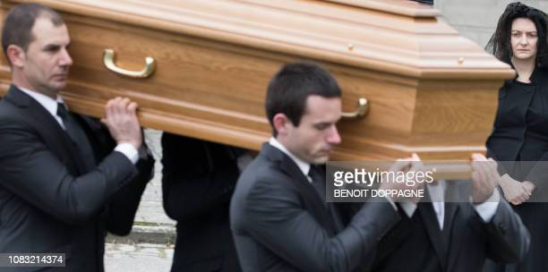 Hereditary Grand Duchess Stephanie of Luxembourg looks on as men carry the coffin at the funeral service for Count Philippe de Lannoy at...