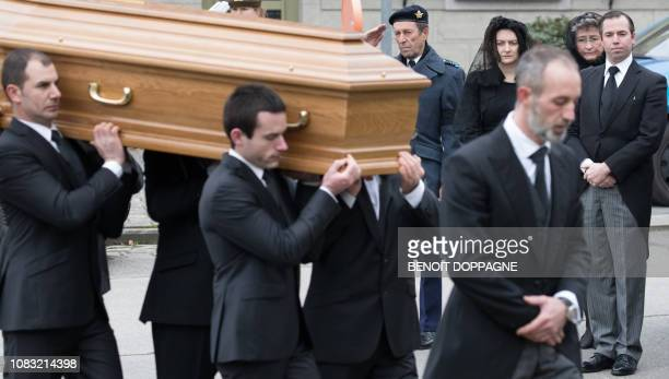 Hereditary Grand Duke Guillaume and Hereditary Grand Duchess Stephanie of Luxembourg look on as men carry the coffin at the funeral service for Count...