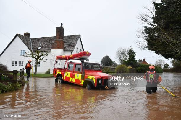 Hereford Fire and Rescue personnel reverse their vehicle as water becomes too deep amid flooding in the village of Hampton Bishop in Herefordshire...
