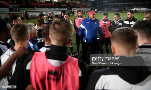 Hereford manager Pete Beadle talks to his players after defeat in the Emirates FA Cup Second Round Replay at Edgar Street Hereford