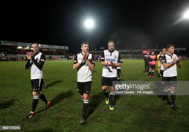 Hereford players salute the crowd after defeat in the Emirates FA Cup Second Round Replay at Edgar Street Hereford