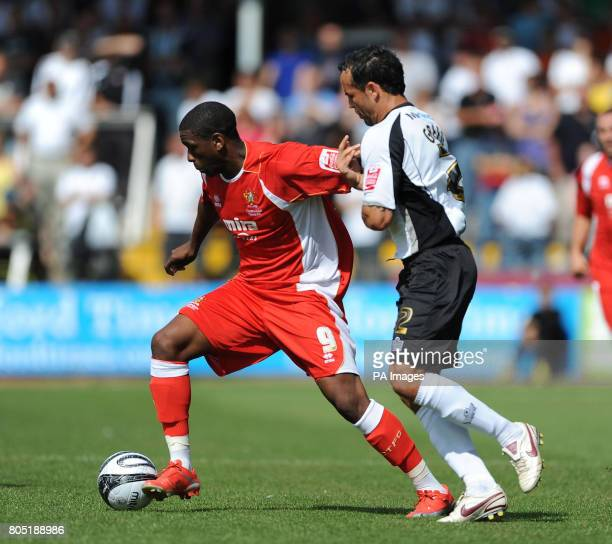 Hereford United's Ryan Green and Cheltenham Town's Justin Richards during the CocaCola League Two match at Edgar Street Hereford
