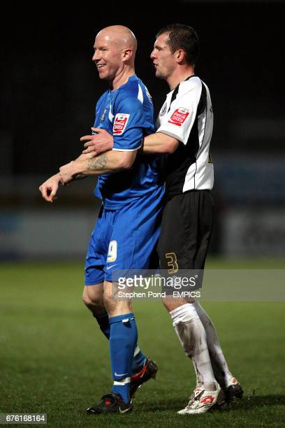 Hereford United's Ryan Valentine stays close to Notts County's Lee Hughes