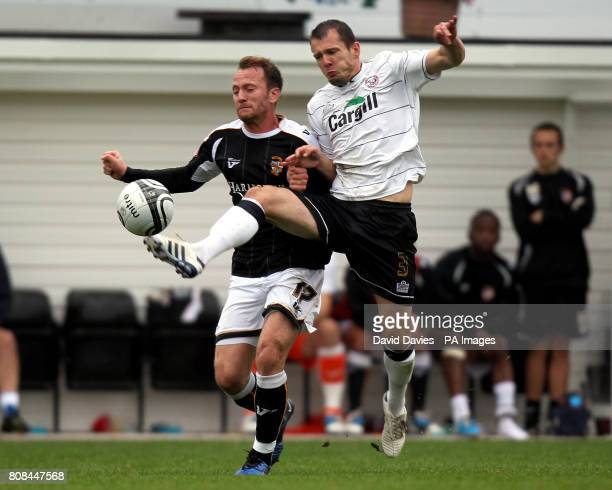 Hereford's Ryan Valentine is challenged by Port Vale's Sean Rigg during the npower League Two match at Edgar Street Hereford