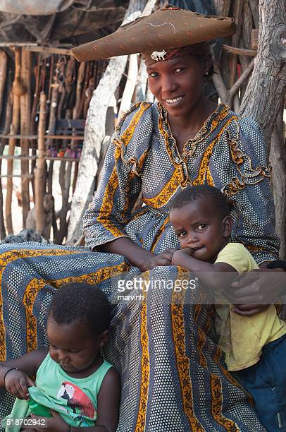 Herero mother with her two children in Namibia