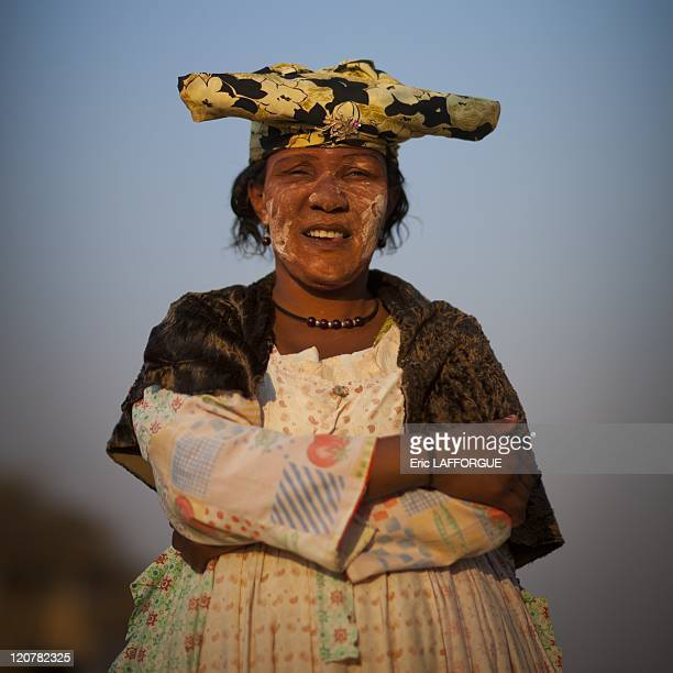 Herero Woman Dressed In Traditional Victorian Style in Opuwo Namibia on August 19 2010 The Hereros are an ethnic group belonging to the Bantu...