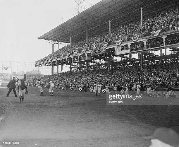 Here's a dramatic scene as the 6th game of the 1956 World Series ended in a Dodger victory when Junior Gilliam crossed the plate with the lone run of...