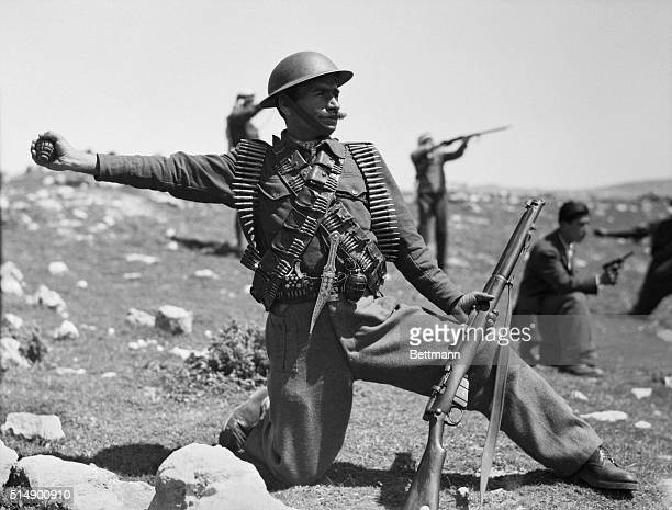 Heres an Arab soldier of the Arab Army of Liberation in the Hebron area of Palestine ready with a grenade in hand to combat Jewish forces Besides a...