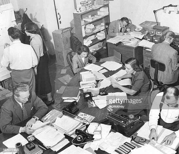 OCT 11 1951 OCT 14 1951 Here's the cubbyhole office of the rapidlygrowing University of Denver Press Around the tables in the forceground are Alan...