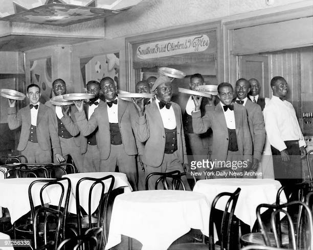 Here's the lineup of waiters who serve you at Small's Paradise in Harlem And there's no cover charge