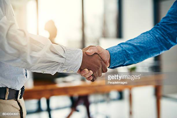 here's to the start of great things - shaking hands stock photos and pictures