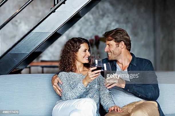 here's to you! - mid adult couple stock pictures, royalty-free photos & images