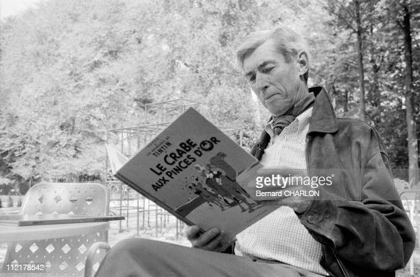 Herge reads a Tintin comic on May 13 1982 in BrusselsBelgium