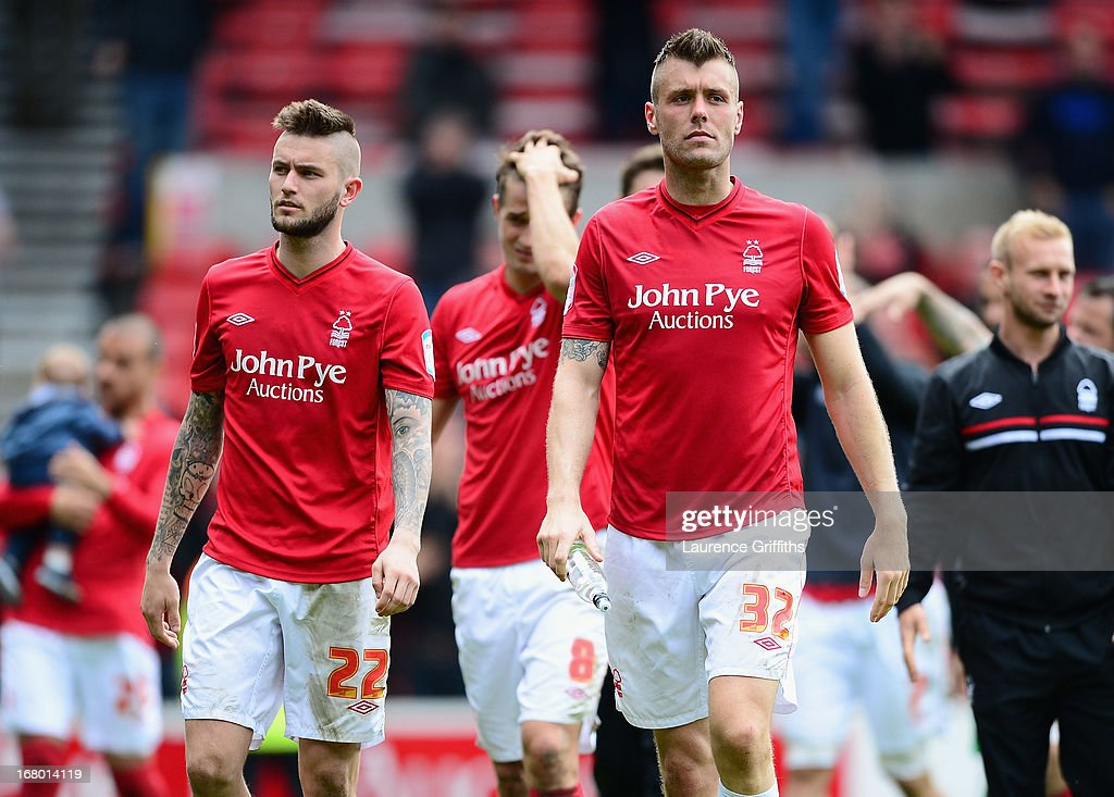Heri Lansbury, and Elliott Ward of Nottingham Forest show their dissapointment in defeat during the npower Championship match between Nottingham Forest and Leicester City at City Ground on May 4, 2013 in Nottingham, England.