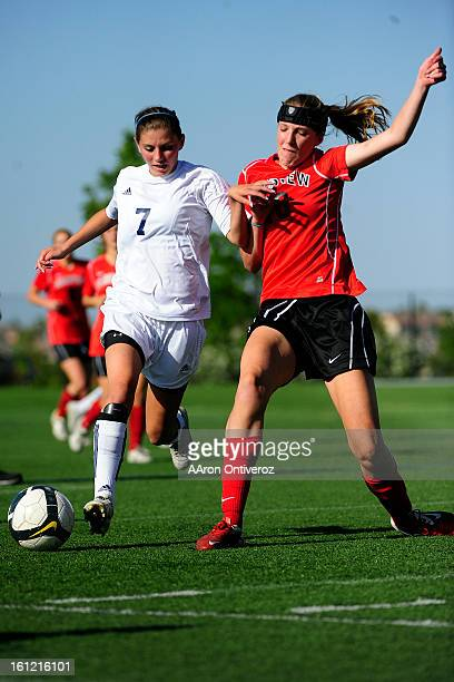 Heritage Eagles forward Jenna Geist and Fairview Knights midfielder Lillian Bitner battle for the ball during Fairview's 10 state quarterfinal win...