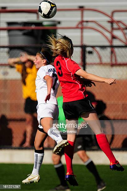 Heritage Eagles forward Jenna Geist and Fairview Knights striker Recl Smith vie for a ball during Fairview's 10 state quarterfinal win against...