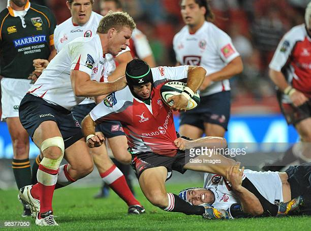 Herkie Kruger of the Lions tackled by Daniel Braid and Ben Daley of the Reds during the Super 14 match between Lions and Reds from Coca Cola Park...