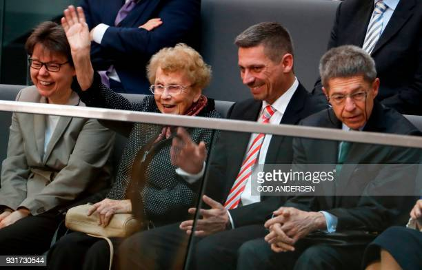 Herlind Kasner, , the mother of German Chancellor Angela Merkel waves, as Joachim Sauer , the Chancellor's husband, and his son Daniel Sauer , and...