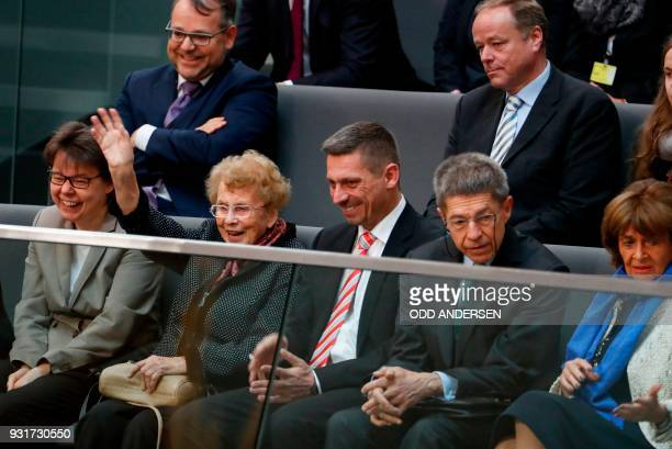 Herlind Kasner, , the mother of German Chancellor Angela Merkel waves, as Joachim Sauer , the Chancellor's husband, and his son Daniel Sauer , her...