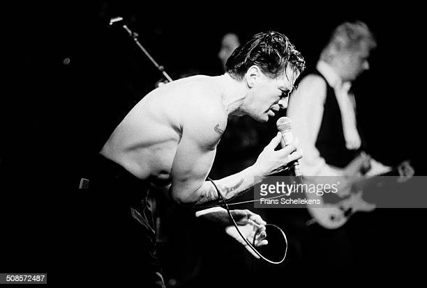 Herman Brood vocal performs with Danny Lademacher gtr at the Paradiso on 26th March 1991 in Amsterdam Netherlands