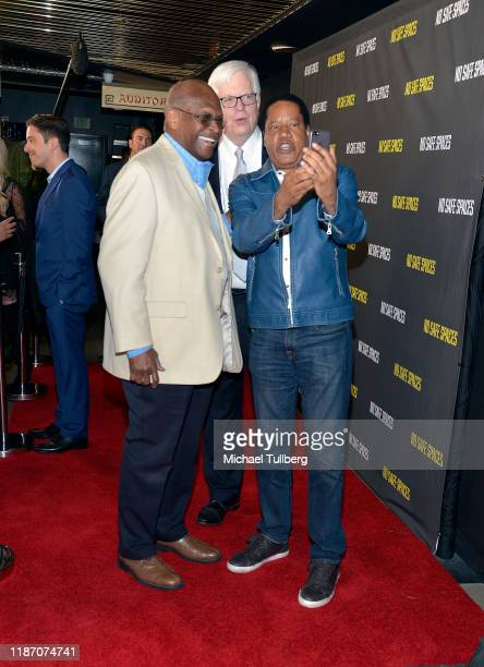 Herman Cain Dennis Prager and Larry Elder take a selfie at the premiere of the film No Safe Spaces at TCL Chinese Theatre on November 11 2019 in...