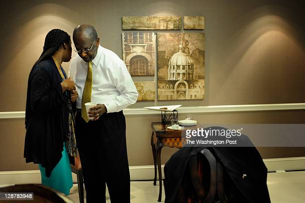 Herman Cain Republican presidential candidate and former GodfatherÕs Pizza CEO speaks to Star Parker while waiting in the 'green room' before...