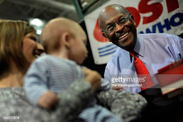 Herman Cain Republican presidential candidate and former Godfather's Pizza CEO signs his recently published biography and meets voters at Costco in...