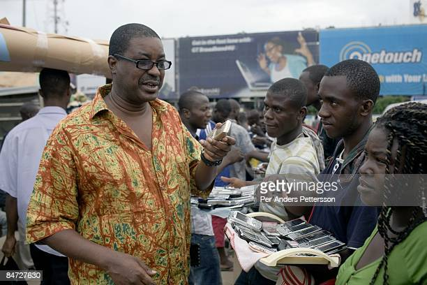 Herman ChineryHesse the founder and CEO of BSL and Soft Tribe holds his mobile phone on June 14 2008 in central Accra Ghana He has built a thriving...