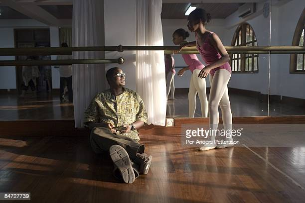 Herman ChineryHesse the founder and CEO of BSL and Soft Tribe holds his mobile phone while attending his daughters dance residual on June 12 2008 in...