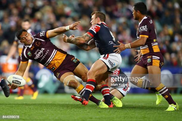 Herman Ese'ese of the Broncos passes as he is tackled during the NRL Qualifying Final match between the Sydney Roosters and the Brisbane Broncos at...