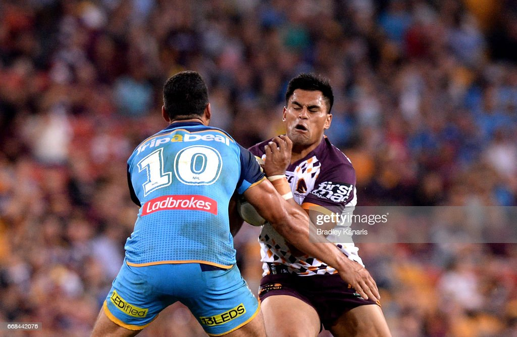 Herman Ese'Ese of the Broncos takes on the defence during the round seven NRL match between the Brisbane Broncos and the Gold Coast Titans at Suncorp Stadium on April 14, 2017 in Brisbane, Australia.