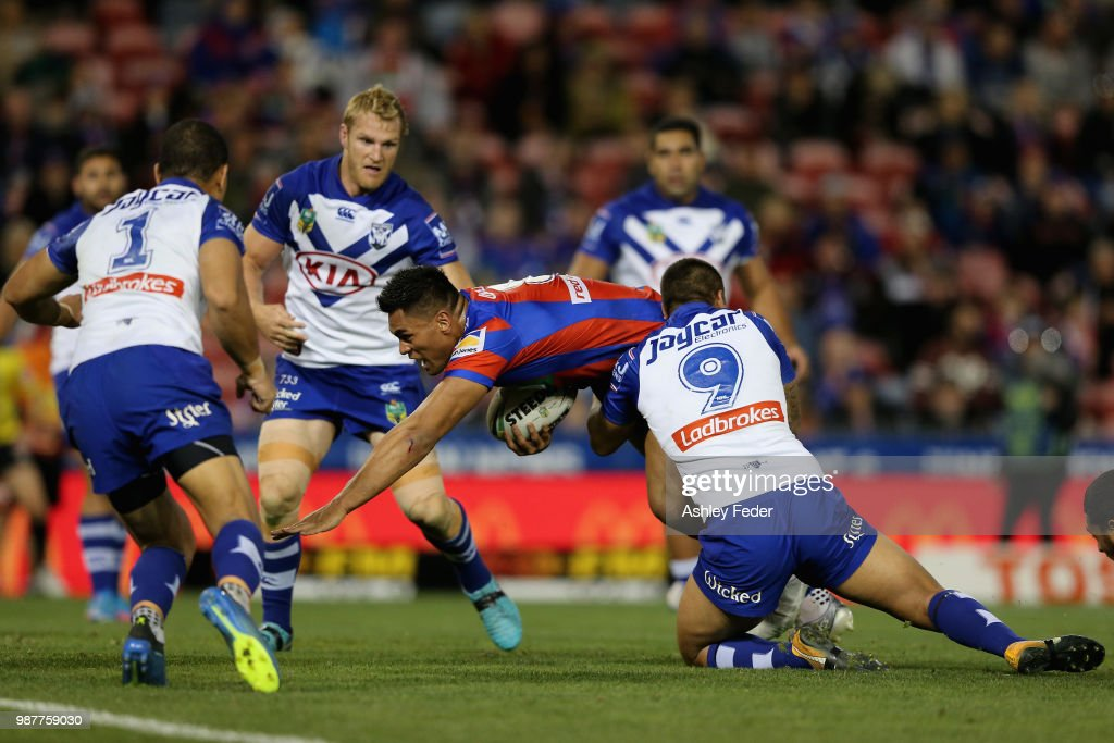 Herman Ese'ese of the Knights scores a try during the round 16 NRL match between the Newcastle Knights and the Canterbury Bulldogs at McDonald Jones Stadium on June 30, 2018 in Newcastle, Australia.