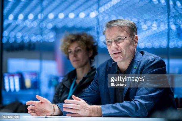 Herman Gref chief executive officer of Sberbank PJSC right gestures while speaking during an interview in London UK on Thursday Dec 14 2017 Sberbank...