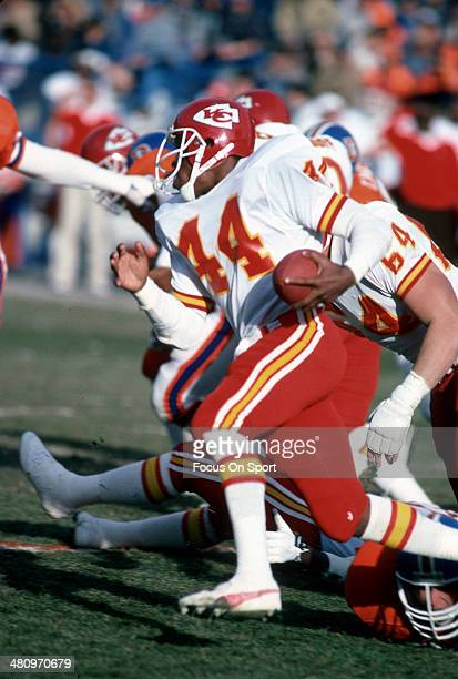 Herman Heard of the Kansas City Chiefs carries the ball against the Denver Broncos during an NFL Football game December 14 1985 at Mile High Stadium...