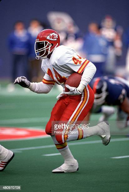 Herman Heard of the Kansas City Chiefs carries the ball against the New York Giants during an NFL Football game December 11 1988 at The Meadowlands...
